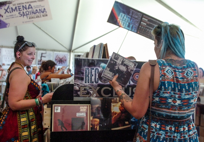 People buy music during Record Store Day at Coachella Valley Music and Arts Festival on Saturday, April 21, 2012. (Rachel Luna / Staff Photographer)