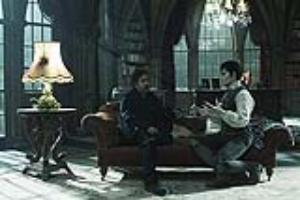 Director Tim Burton, left, and Johnny Depp on set during the production of Warn