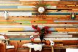 Sarah Reiss sources reclaimed wood to make custom wall art. Sheâ  s used gymnas