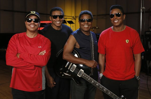 Marlon, left, Jackie, Tito and Jermaine Jackson pose together during a rehearsal in Burbank. (Photo by Todd Williamson/Invision/AP)