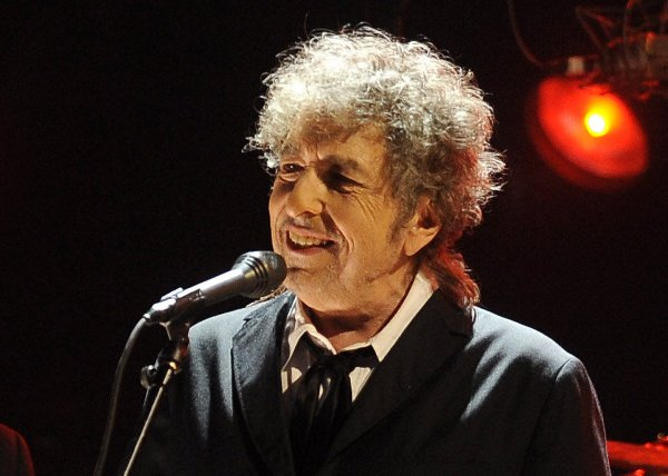 "Bob Dylan, seen performing in Los Angeles on Jan. 12, 2012, went electric with a Fender Stratocaster guitar at the Newport Folk Festival in 1965. That instrument is slated to be featured on PBS' ""History Detectives."" (AP Photo/Chris Pizzello, File)"