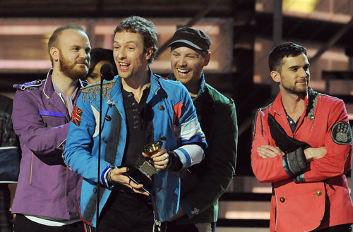 """Chris Martin (2nd L) and other members of the band Coldplay, celebrate  after winning the Grammy Award for the Best Rock Album for their album  """"Viva La Vida Or Death And All His Friends"""" during the 51st annual  Grammy awards held at the Staples Center in Los Angeles on February 8,  2009."""