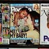 Copies of the latest People Magazine  featuring Sandra Bullock and her newly-adopted son Louis Bardo Bullock, center, are show on sale in New York, Wednesday, April 28, 2010. (AP Photo/Jeff Christensen)
