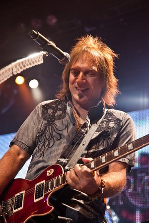 Dave Amato, who plays lead guitar and sings harmony in REO Speedwagon, performs with the group on Saturday, July 31, 2010 at the Greek Theatre in Los Angeles. (Chris Selden/Special to the Daily News)