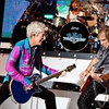 Kevin Cronin, left, and Dave Amato, right, with drummer Bryan Hitt of REO Speedwagon play their hits on Saturday, July 31, 2010 at the Greek Theatre in Los Angeles. (Chris Selden/Special to the Daily News)