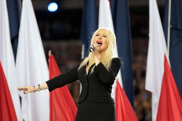 Singer Christina Aguilera sings the National Anthem during Super Bowl XLV between the Pittsburgh Steelers and the Green Bay Packers at Cowboys Stadium on Feb. 6, 2011 in Arlington, Texas.