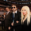 Singer Christina Aguilera (R) and Matthew Rutler attend the Bridgestone Super Bowl XLV Pregame Show at Dallas Cowboys Stadium on Feb. 6, 2011 in Arlington, Texas.