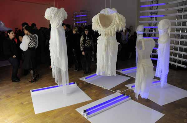 """This Wednesday, Feb. 23, 2011 photo shows guests by  the installation """"White Collection,"""" during a  preview of the art exhibition """"Rodarte: States of Matter,""""  at the Museum of Contemporary Art in West Hollywood, Calif.  (AP Photo/Chris Pizzello)"""