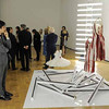 "This Wednesday, Feb. 23, 2011 photo shows a guest at a preview of the art exhibition ""Rodarte: States of Matter,"" as he studies the installation ""Red Collection,"" at the Museum of Contemporary Art in West Hollywood, Calif.  (AP Photo/Chris Pizzello)"