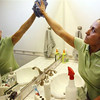 In this March 10, 2011 photo Merry Maids employee Esther Jimenez cleans the bathroom of a home in Burbank, Calif. Spring cleaning is easier and more efficient if you use the right tools, techniques and products.