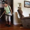 In this March 10, 2011 photo Merry Maids employee Esther Jimenez cleans the floors of a home in Burbank, Calif. Spring cleaning is easier and more efficient if you use the right tools, techniques and products.