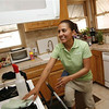 In this photo taken March 10, 2011, Merry Maids employee Esther Jimenez cleans the kitchen of a home in Burbank, Calif. Spring cleaning is easier and more efficient if you use the right tools, techniques and products.