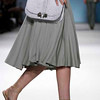 This Sept. 12, 2010 file photo shows fashion from the Derek Lam Spring 2011 collection modeled during Fashion Week in New York. The big fashion trend for this spring is longer lengths _ below-the-knee skirts, maxi dresses and flared-leg trousers.   (AP Photo/Bebeto Matthews, FILE)