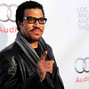 Singer Lionel Richie poses at the 16th Annual Los Angeles Antique Show Opening Night Gala to benefit P.S. Arts, Wednesday, April 13, 2011, in Santa Monica, Calif. (AP Photo/Chris Pizzello)