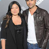 Jenna Ushkowitz, at left, and John Stamos arrive to The T-Mobile Sidekick 4G Launch Party  on Sunday April 20, 2011, in Beverly Hills, Calif. (AP Photo/Katy Winn)