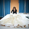In this undated photo released by the Royal Collection on Thursday April 21 2011, the silk satin wedding dress worn by Queen Victoria in 1840, when she married Albert Saxe-Coburg, is prepared by a conservator for conservation work to begin. As speculation continues as to the design of Catherine Middleton's wedding dress, a precious collection of historic royal wedding dresses worn by royal brides over the last 200 years have just undergone over 1000 hours of conservation treatment by conservators from Britain's Historic Royal Palaces. The wedding dresses belonging to Princess Charlotte (1816), Queen Victoria (1840), Alexandra of Denmark (1863), Princess Mary of Teck (1893), Princess Margaret (1960) and Princess Alexandra of Kent (1963) are usually carefully stored at Kensington Palace but have been made available to the media and are viewable on the Historic Royal Palaces website. (AP Photo/The Royal Collection/Historic Royal Palaces)