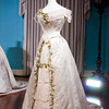 In this undated photo released by the Royal Collection on Thursday April 21 2011, a white satin dress decorated with a pattern of British and Irish flowers, tied together with a lovers knot was worn by Princess (Victoria) Mary of Teck when she married Prince George, Duke of York (later King George V) in 1893. As speculation continues as to the design of Catherine Middleton's wedding dress, a precious collection of historic royal wedding dresses worn by royal brides over the last 200 years have just undergone over 1000 hours of conservation treatment by conservators from Britain's Historic Royal Palaces. The wedding dresses belonging to Princess Charlotte (1816), Queen Victoria (1840), Alexandra of Denmark (1863), Princess Mary of Teck (1893), Princess Margaret (1960) and Princess Alexandra of Kent (1963) are usually carefully stored at Kensington Palace but have been made available to the media and are viewable on the Historic Royal Palaces website. (AP Photo/The Royal Collection/Historic Royal Palaces)