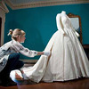 In this undated photo released by the Royal Collection on Thursday April 21 2011, a conservator puts finishing touches to the simple but stunning wedding dress worn by HRH Princess Margaret when she married Lord Snowdon in 1960. The glamorous dress comprised a fitted bodice and a full skirt of fine diaphanous silk. As speculation continues as to the design of Catherine Middleton's wedding dress, a precious collection of historic royal wedding dresses worn by royal brides over the last 200 years have just undergone over 1000 hours of conservation treatment by conservators from Britain's Historic Royal Palaces. The wedding dresses belonging to Princess Charlotte (1816), Queen Victoria (1840), Alexandra of Denmark (1863), Princess Mary of Teck (1893), Princess Margaret (1960) and Princess Alexandra of Kent (1963) are usually carefully stored at Kensington Palace but have been made available to the media and are viewable on the Historic Royal Palaces website. (AP Photo/The Royal Collection/Historic Royal Palaces)