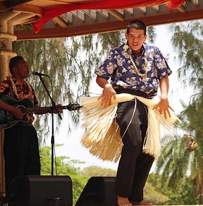 a very energetic and entertaining hula dancer. the guys wear skirts too ,  Photographer: Katherine Finch, web: http://finches.smugmug.com/