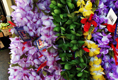 Leis on the street, artificial leis for sale in Chinatown, HNL, Hawaii  www.finches.smugmug.com