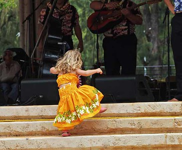 little hula dancer, This little girl just spontaneously left her mother, ran up on stage and danced. Her mother said she'd never done anything like that before.  ,  Photographer: Katherine Finch, web: http://finches.smugmug.com/