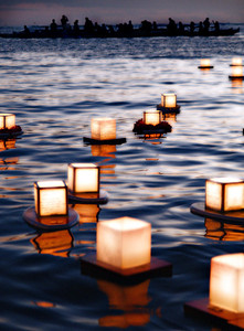 Floating Lights Ceremony, Memorial Day  Ala Moana Park, HNL taken at sunset, waist deep in water. other shots:  www. finches.smugmug.com