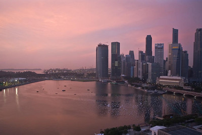 "Marina Bay at sunrise with ""Wishing Spheres"" floating, awaiting New Year's Eve.  .... Photographed by Jack Ebey"