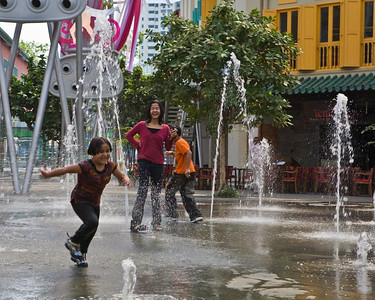 Kids at play at Clarke Quay  .... Photographed by Jack Ebey