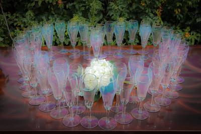 Iridescent Champagne Glasses Make a Heart Around Hydrangea Blossoms