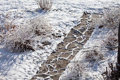 Snow Outlines on Slate Path