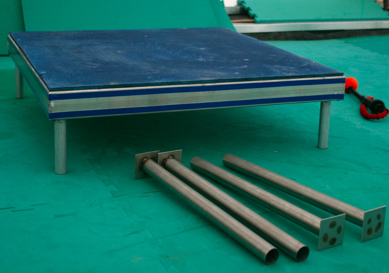 Table: two heights, aluminum or powder-coated steel construction. Contact surface can be finished by the manufacturer, or you can do it on your own.