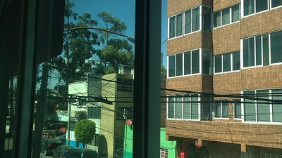 View outside my bedroom window (for now).  & what color is THIS Sky???  This is the color EVERY DAY this past week!!  The trees 1/2 block away are at the MAIN Street which takes me to an Americana-style mall with the BEST Market I've seen since I was back in the U.S. & a movie theatre with 6 theatres (most in English with Spanish SubTitles) & Sushi - 10 pieces for $3-$4!!  & MORE!!