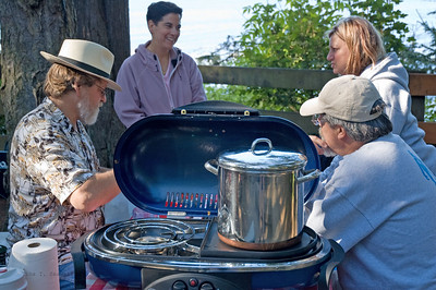 Jerry, Marylou, Jill, and Steve enjoy cocktail hour while the beans simmer over the campstove.