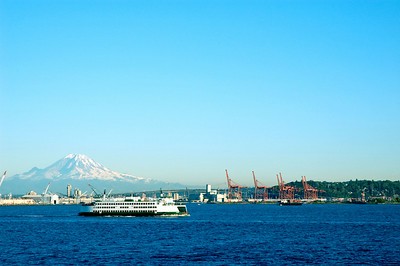 The Bainbridge ferry crossing in front of Mount Rainer and the Port of Seattle.