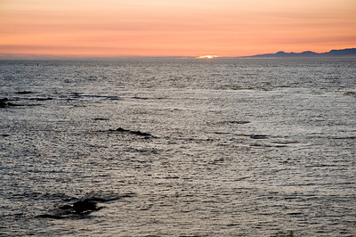 The sun melts into the Strait of Juan de Fuca.