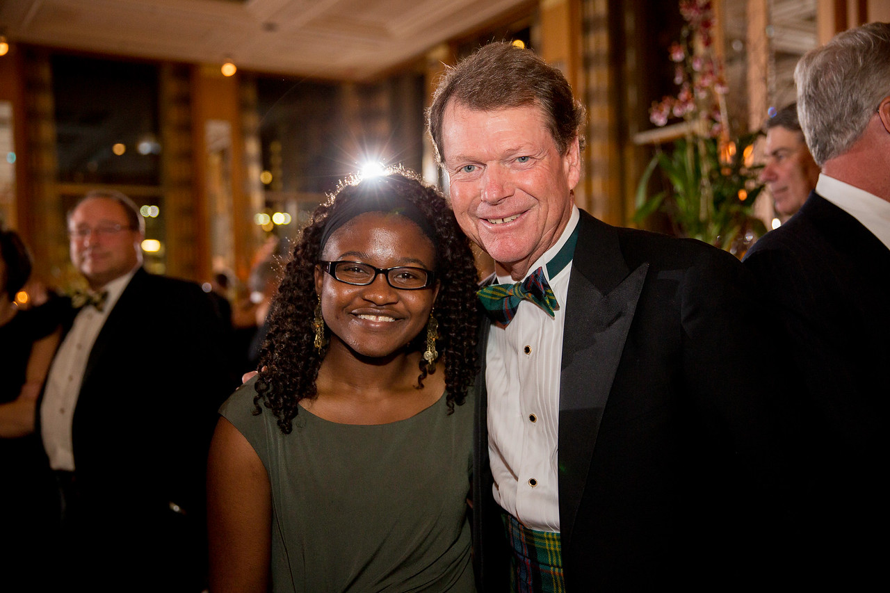 Marquette University Evans Scholar Maryclaret Ndubuisi-Obi with golf legend Tom Watson at the Western Golf Association's Green Coat Gala benefiting the Evans Scholars at The Peninsula Chicago hotel on Friday, Nov. 9, 2012. © Charles Cherney Photography