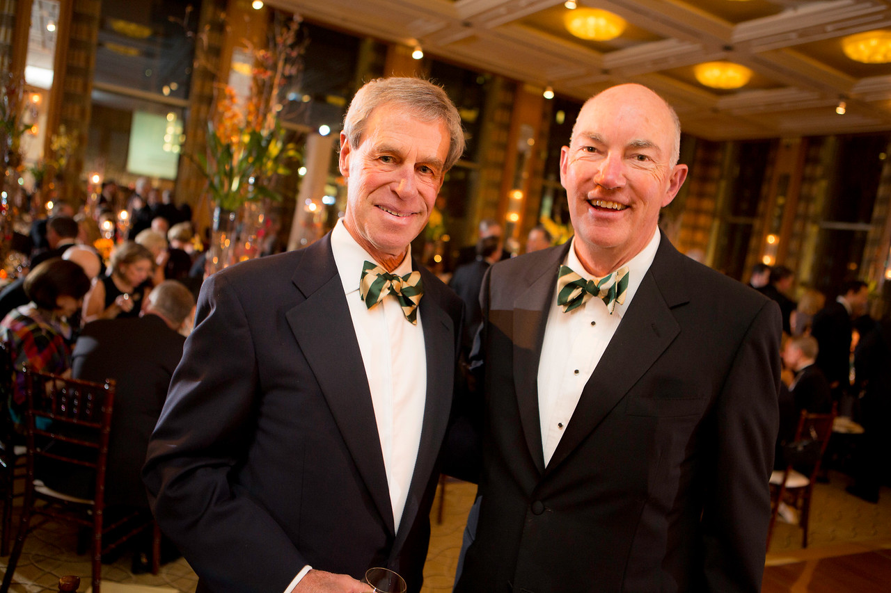 Western Golf Association director Mike Keiser of Chicago and WGA Chairman Jim Bunch of Denver at the second annual Green Coat Gala benefiting the Evans Scholars at The Peninsula Chicago hotel, including guest-of-honor Tom Watson, on Friday, Nov. 9, 2012.<br /> © Charles Cherney Photography