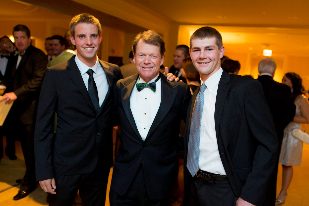 Golf legend Tom Watson is flanked by 2012 Western Amateur champion Chris Williams of Moscow, Idaho (left) and 2012 Western Junior champion Adam Wood of Zionsville, Ind. at the Western Golf Association's Green Coat Gala benefiting the Evans Scholars at The Peninsula Chicago hotel on Friday, Nov. 9, 2012.<br /> © Charles Cherney Photography