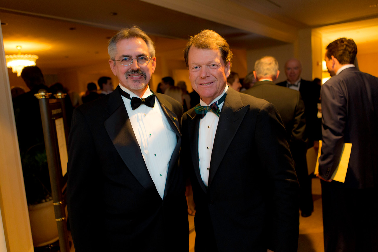 Bob Maibusch of Willowbrook (left) caddied for Tom Watson (right) at the 1974 Western Open, Watson's first PGA Tour victory.  Western Golf Association's Green Coat Gala benefiting the Evans Scholars took place at The Peninsula Chicago hotel on Friday, Nov. 9, 2012.<br /> © Charles Cherney Photography