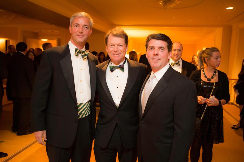 Golf legend Tom Watson (center) with Kevin Buggy (left) and Jim Roppel, both of Park Ridge, at the Western Golf Association's Green Coat Gala benefiting the Evans Scholars at The Peninsula Chicago hotel on Friday, Nov. 9, 2012. © Charles Cherney Photography