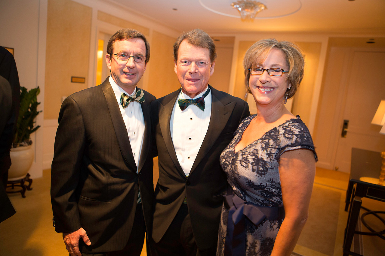 Dinner committee members Clare and Bill Sullivan of Glenview pictured with golf legend Tom Watson, keynote speaker at the Western Golf Association's Green Coat Gala benefiting the Evans Scholars Foundation at The Peninsula Chicago hotel on Friday, Nov. 9, 2012. © Charles Cherney Photography