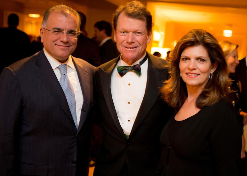 Sunny and Gery Chico with golf legend Tom Watson at the Western Golf Association's Green Coat Gala benefiting the Evans Scholars at The Peninsula Chicago hotel on Friday, Nov. 9, 2012. © Charles Cherney Photography
