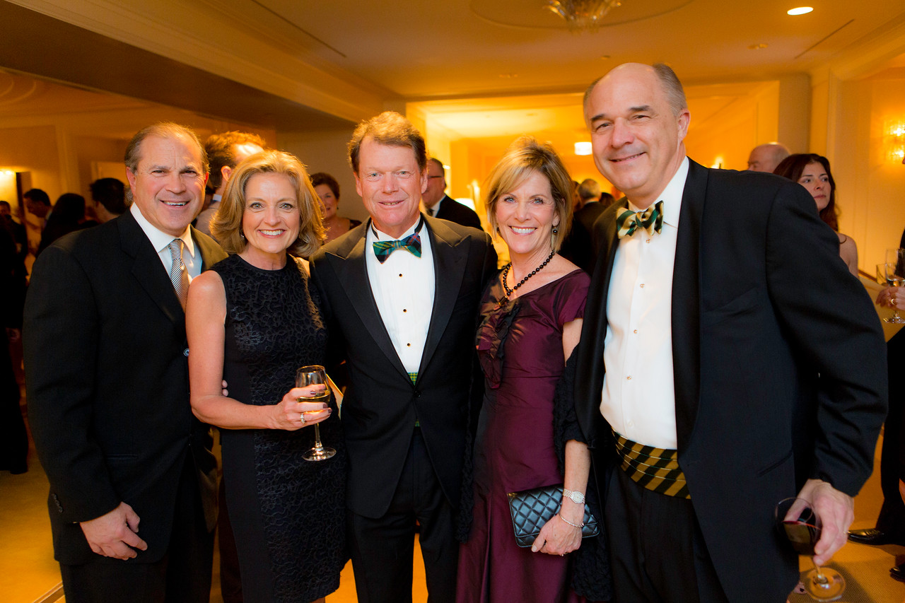 Dinner committee members Jill and Jay Javors of Chicago (right) and Carol and Don Pelino of Hinsdale pictured with golf legend Tom Watson, keynote speaker at the Western Golf Association's Green Coat Gala benefiting the Evans Scholars Foundation at The Peninsula Chicago hotel on Friday, Nov. 9, 2012. © Charles Cherney Photography