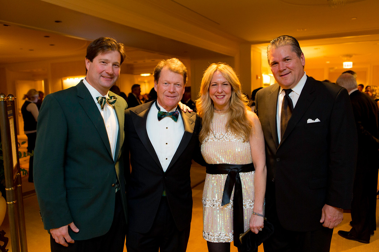 WGA director Josh Lesnik and wife Judy, of Winnetka with Tom Watson and Bill Kingore of Chicago at the Western Golf Association's Green Coat Gala benefiting the Evans Scholars at The Peninsula Chicago hotel on Friday, Nov. 9, 2012. © Charles Cherney Photography