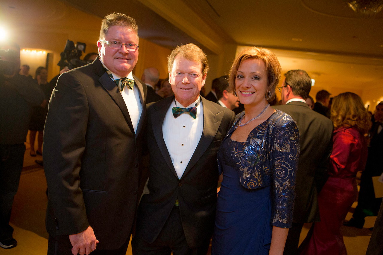 Dinner committee members Donna and Mike Donovan of Park Ridge pictured with golf legend Tom Watson, keynote speaker at the Western Golf Association's Green Coat Gala benefiting the Evans Scholars Foundation at The Peninsula Chicago hotel on Friday, Nov. 9, 2012. © Charles Cherney Photography
