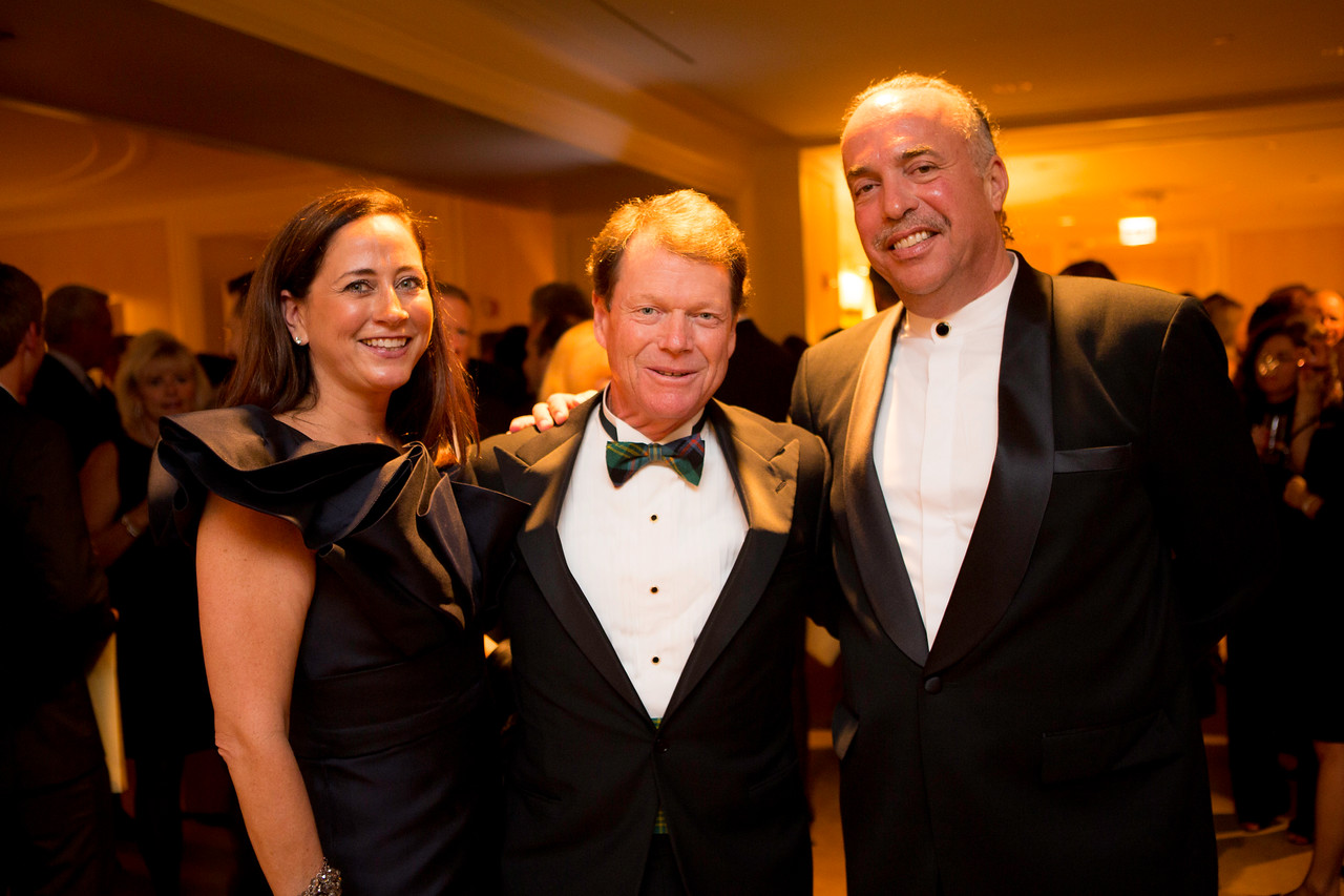 Jean and Andy Antoniou with golf legend Tom Watson (center) at the Western Golf Association's Green Coat Gala benefiting the Evans Scholars at The Peninsula Chicago hotel on Friday, Nov. 9, 2012. © Charles Cherney Photography