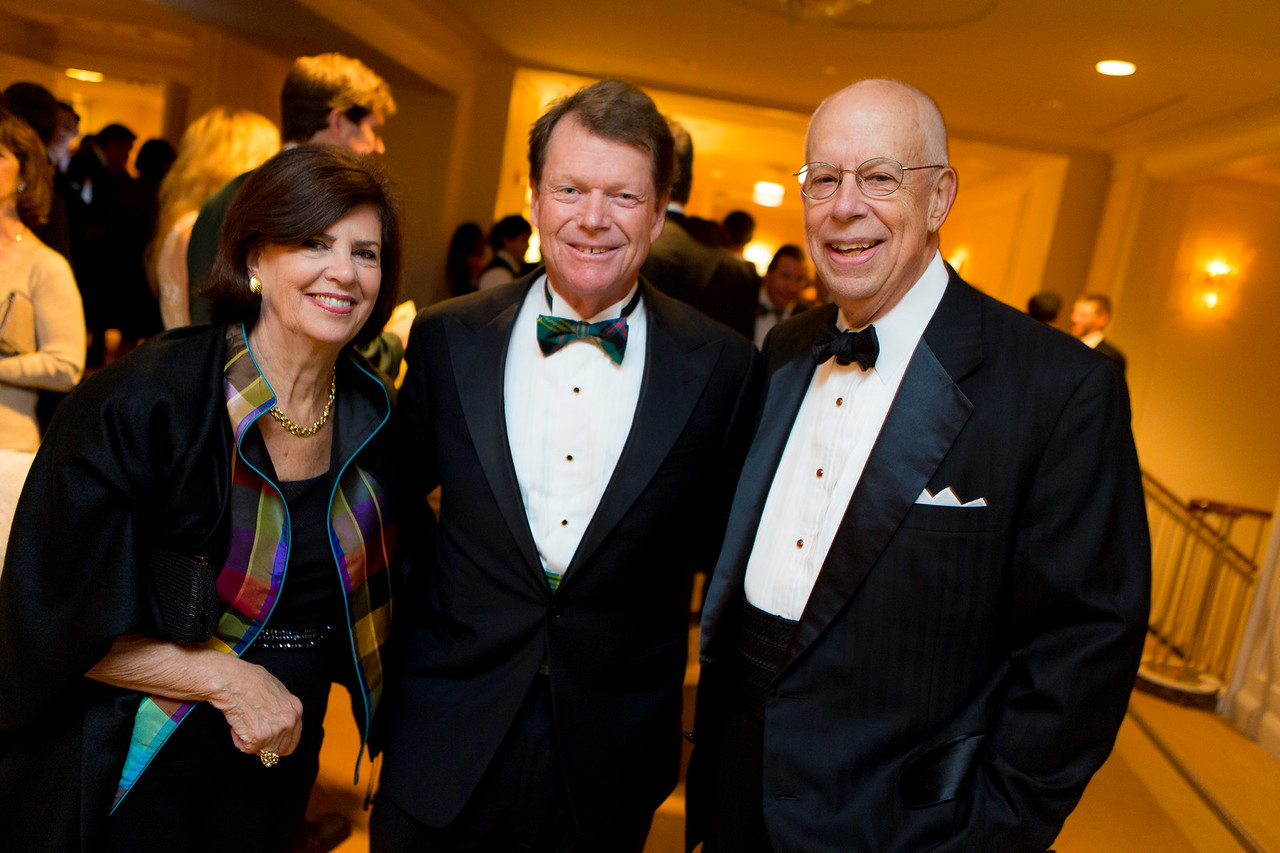 Raynelle and Bob Heidrick with golf legend Tom Watson at the Western Golf Association's Green Coat Gala benefiting the Evans Scholars at The Peninsula Chicago hotel on Friday, Nov. 9, 2012. © Charles Cherney Photography