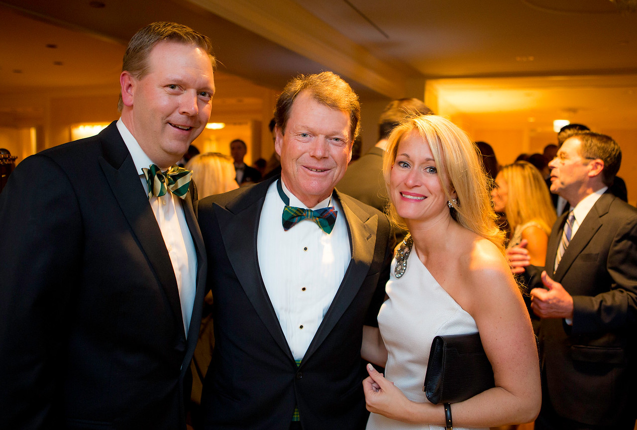 Dinner committee members Jessica and Mark Wiktor of River Forest pictured with golf legend Tom Watson, keynote speaker at the Western Golf Association's Green Coat Gala benefiting the Evans Scholars Foundation at The Peninsula Chicago hotel on Friday, Nov. 9, 2012. © Charles Cherney Photography