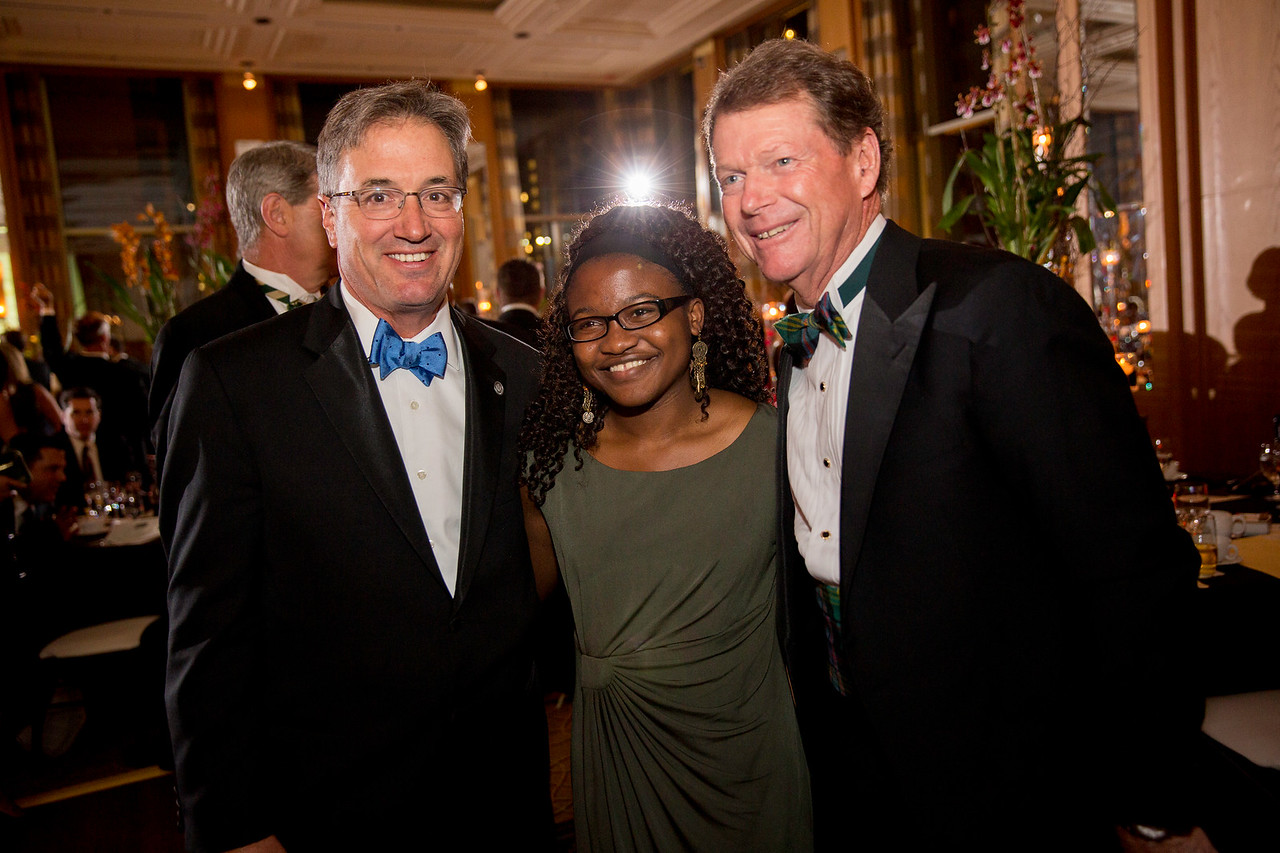 Jim Murphy of Chicago with Marquette University Evans Scholar Maryclaret Ndubuisi-Obi and golf legend Tom Watson at the Western Golf Association's Green Coat Gala benefiting the Evans Scholars at The Peninsula Chicago hotel on Friday, Nov. 9, 2012. © Charles Cherney Photography