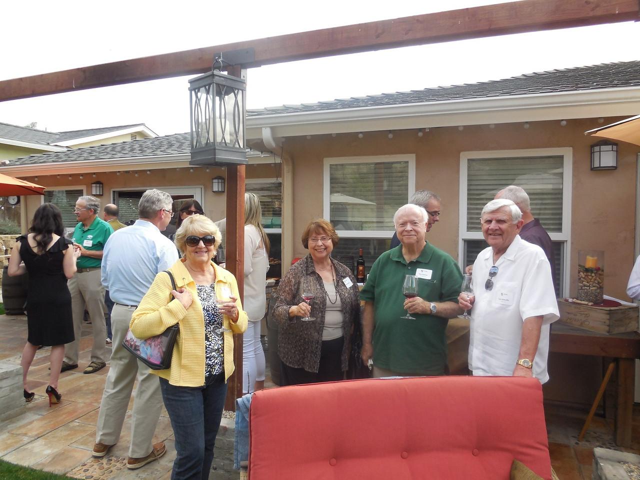 Carol Domville, Sandy Homicz, Ray Homicz (Mich. '59) and Tom Domville (Kansas '59).